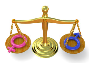 Gold scale evenly holding gender signs, sex equality
