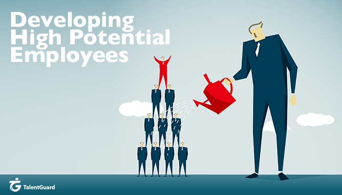Employer watering a group of high potential employees stacked into a pyramid, with the employee on top of the pyramid cheering