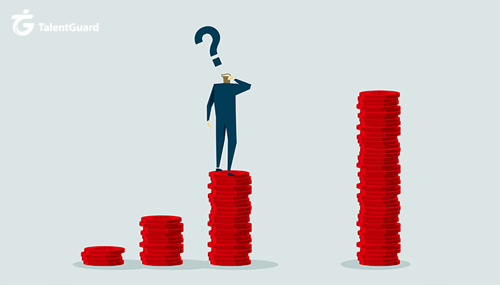 Man standing on stack of coins, scratching his head with a question mark above his head